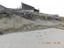 Erosion below house
