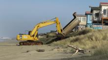 Track hoe on beach.