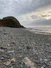 Gravel and rock ocean picnic beach facing south