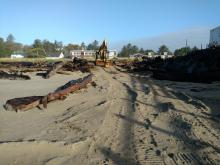 Excavator parked west of Mo's Restaurant on Siletz Bay