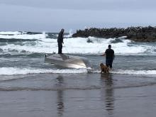 Assessing the Situation of capsized boat, Nedonna Beach
