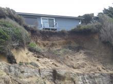 Erosion under blue house.