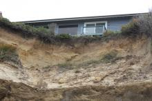 Current status of erosion under blue house