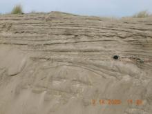 Layered sand deposits forming sand bluff