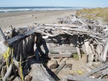 This structure had been partially disassembled in our last visit, but has been rebuilt.  Fire evidence was greater and trash was more extensive.