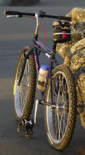 Highly modified mountain bike with super-wide tires. Single speed. Four to five times faster than walking, and great for riding through small creeks and small waves.