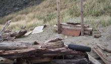 Small structure built at edge of beach had some concentration of trash and a tire