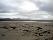The Siltcoos River as it meanders out to sea along Siltcoos Beach.