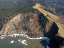 View of the landslide from the west. This photo shows the trails and the rocky beach just south of the slide.