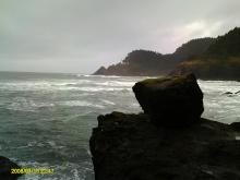 Looking Northward at the lighthouse with rocks of Sea Lion Point in the foreground.