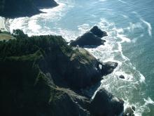 Heceta Head from ultralight plane (note hidden arch below lighthouse).