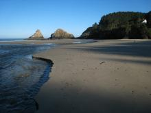 View of the sand to the rocks from Cape Creek
