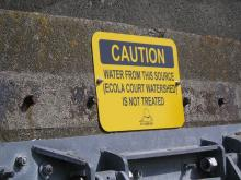 sign above outfall pipe.