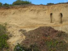 Initials on cliff three months ago are almost gone this time, most likely to errosion in the sand stone bluff. same location as prior photo in  September.