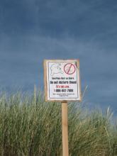 Seal pup warning sign posted.