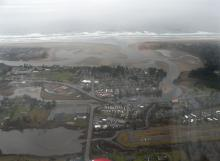 Seaside on left or south, Gearhart on the right or north side of River.  Seaside Airport runway lower right.