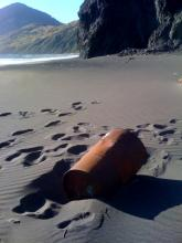 Photo of the oil filled barrel on the beach at Mile 43