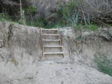 Access to the beach has been closed by trailer park, but the path these stairs end at is on public land along a cliff face of Mussel Reef, reached by a rather harrowing pathway up the cliff.