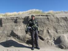 "Dave (6' 2"") is standing next to the largest riptide embayment erosion on Mile 97."