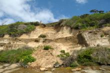 A broader view of erosion of a home overlooking Ona Beach.