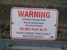 new and very much improved sign warning the public about possible contamination