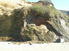 A large chunk of the cliff face separated and fell to the beach south of Grant Creek.