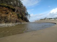 Neskowin Creek flowing around Proposal Rock