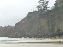 Erosion/rock fall of part of headland structure/cliff, north end of mile.