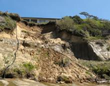 Erosion of the cliff is getting closer to the house. The house seems to be abandoned.