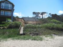 Photo shows foundation and piers set deep into the sand.