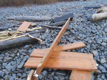Portion of dock found on rocks midway point of Mile 309; two attached lumber tags indicate US Company.