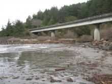 Myers Crk marks N end of mile 23: surf pushing under 101 bridge in creek channel. King tide