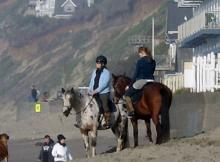 Horse riders on he beach