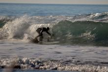 The waves were good for surfing and several wetsuit clad folks enjoyed the afternoon near SW 35th Street.