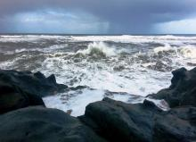 Standing at western tip of Fishing Rock watching storm approaching and churning sea. Rain is on its way.