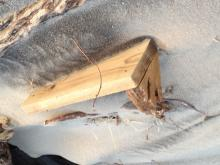 Man made wooden debris found in dunes south of the Inn at Spanish Head