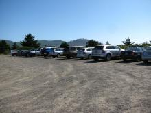 One side of the full parking lot - 46 vehicles including 2 horse trailers and 2 construction excavators.