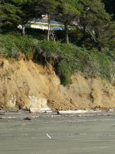 north of alpine chalet access, house sitting on bluff that's slowly eroding-small slide/mass wasting.