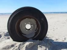 Photo of tire found on beach.