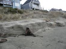 Sand seems to have washed away by about 3 feet.No apparent threat or damage to homes.