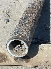 Heavy fiberglass tube approx. 1m long with pelagic barnacles inside.  Could not find any writing on it.  Too heavy to carry out.
