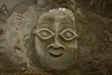 Etched face in the sandstone wall