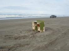 desk dumped in the sand