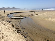 Creek on the beach is further south before it curves west to go to the ocean.