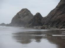 Looking North from Cove Beach towards the Arch Cape at +2.0 tide.More sand accumulated than in years. Recent storm added to sand deposits on the rocks.