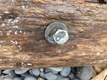 two bolts on the piece of wood