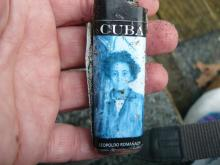 Writing on front and back of lighter. Looked up; Leopoldo Romanach Coleccion De Arte Cubano