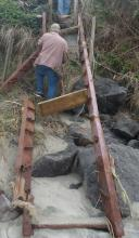 Stairs that have been virtually demolished in this fall's/winter's damaging storms/waves are being replaced