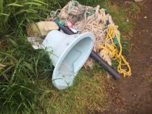 Toilet found in beach debris, Tillamook County, Lost Bay Cave, Short Beach