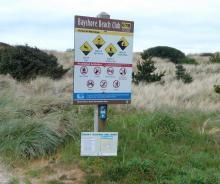 Snowy Plover sign at Bayshore Beach Club beach access, 67B
